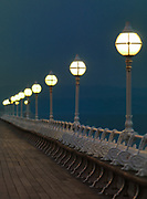 Victorian pier and iron work adorn the Princess Pier at Torquay on the English Coastline with lighted bulbs