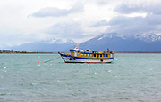 A sight seeing boat anchored in a choppy Canal Senoret off Puerto Natales on a typical gloomy and windy day. Puerto Natales, Republic of Chile. 17Feb13
