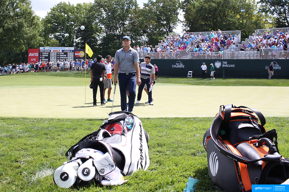 Jordan Spieth, USA, throws his ball into the crowd after completing the first round on the ninth hole during The Barclays Golf Tournament at The Plainfield Country Club, Edison, New Jersey, USA. 27th August 2015. Photo Tim Clayton