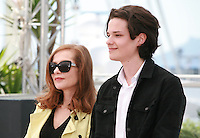 Actress Isabelle Huppert and actor Jules Benchetrit at the Asphalte - Macadam Stories film photo call at the 68th Cannes Film Festival Sunday May 17th 2015, Cannes, France.