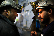 Seven miners are refusing to leave a dark gallery deep underground at a coal mine in northern Spain unless the government reverses its decision to slash subsidies to the sector.<br /> During a visit on Tuesday, the miners, their faces and uniforms covered in soot, played cards to pass the time and keep their spirits up after having already spent 34 days some 800 meters (2,625 feet) below the earth at the mine near Santa Cruz del Sil.