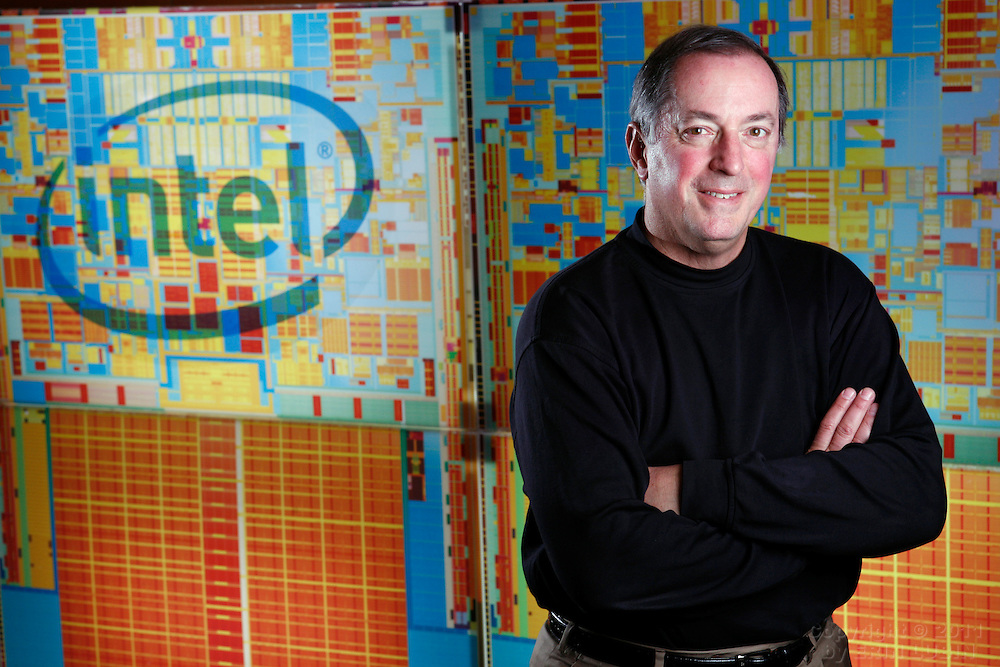 Recognizing the 60th anniversary of the transistor - a key component in a microprocessor - Intel President and Chief Executive Officer Paul Otellini displays the projected size of today's Intel® 45nm processors if the transistors were identical to those in Intel's first product in 1971.  Intel's innovations in transistor design ensure PCs and mobile devices are smaller, faster and more energy-efficient than ever.   ..While the Intel 4004 processor in 1971 housed some 2,300 transistors, our recently introduced Intel® 45nm Core(TM) 2 Extreme processor holds more than 820 million transistors.. .Photo by Erin Lubin.