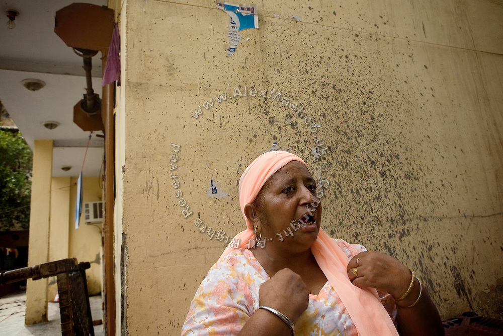 Gurdeep Kaur, 52, is portrayed discussing animatedly in Tilak Vihar, New Delhi, India. She has lost her husband and other members of her family during the anti-Sikh riots erupted in New Delhi in 1984 in the light of Indira Gandhi's assassination by her Sikh bodyguards.