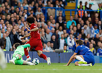 Football - 2018 / 2019 Premier League - Chelsea vs. Liverpool<br /> <br /> Mohamed Salah (Liverpool FC) leaves Marcos Alonso (Chelsea FC) on the floor and rounds Kepa Arrizabalago (Chelsea FC) <br /> at Stamford Bridge <br /> <br /> COLORSPORT/DANIEL BEARHAM