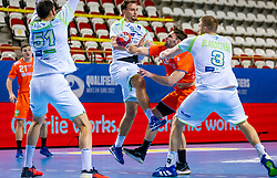 The Dutch handball player Jorn Smits in action against Darko Cingesar, Blaz Blagotinsek from Slovenia during the European Championship qualifying match on January 6, 2020 in Topsportcentrum Almere