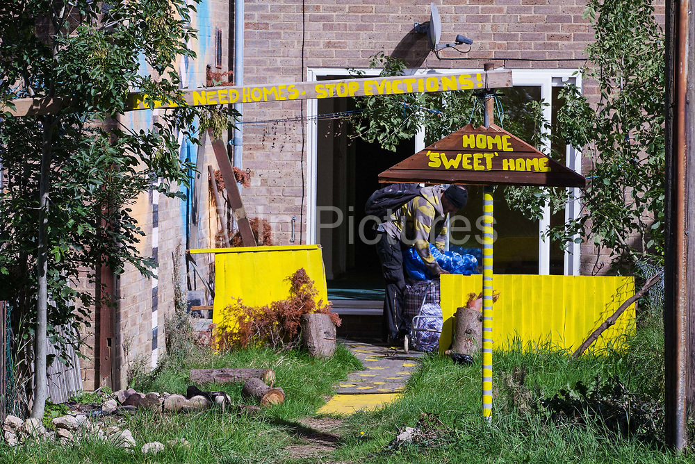 A housing activist prepares to leave a property on the Sweets Way housing estate after having been evicted by bailiffs on 23rd September 2015 in London, United Kingdom. A group of housing activists calling for better social housing provision in London had occupied some of the properties on the 142-home estate in Whetstone, in some cases refurbishing properties intentionally destroyed by the legal owners following eviction of the original residents, in order to try to prevent the eviction of the last resident on the estate and the planned demolition and redevelopment of the entire estate by Barnet Council and Annington Property Ltd.
