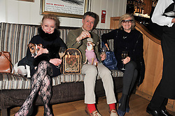 Left to right, SUE McGEE, BRIAN O'CALLAN and PAULINE VAN LUVEN and dogs Little Jack and lady Belle at the launch of George's Dinner for Dogs menu in aid of The Dog's Trust held at George, 87-88 Mount Street, London on 19th March 2013.