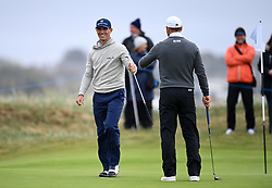 Billy Horschel (left) bumps fists with Martin Kaymer after sinking a long putt on the third green during day one of the Alfred Dunhill Links Championship at Carnoustie. Picture date: Thursday September 30, 2021.