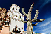 An Arizona image showing a large saguaro cactus in front of the Mission San Xavier del Bac. Missoula Photographer