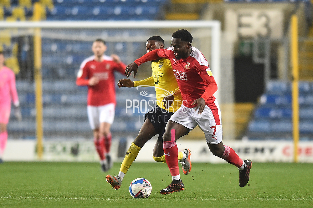 Swindon Twn Midfielder Diallang Jaiyesimi (7) and Oxford United forward Olamide Shodipo (25) battles for possession during the EFL Sky Bet League 1 match between Oxford United and Swindon Town at the Kassam Stadium, Oxford, England on 28 November 2020.