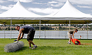 Francisco Cervantes, left, of Statewide Rent-A-Fence in Seattle, rolls up some of the 18,000-feet of chain-link fence while Benjamin Howard, 12, of Pasco, whose grandfather is Water Follies Pasco Operations Chairman Chuck Keltch, rolls up some of the 950-feet of plastic fencing on the Pasco side after the 2008 races.