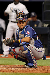 April 18, 2018 - St. Petersburg, FL, U.S. - ST. PETERSBURG, FL - APR 18: Robinson Chirinos (61) of the Rangers looks into the dugout for the coaches call during the MLB regular season game between the Texas Rangers and the Tampa Bay Rays on April 18, 2018, at Tropicana Field in St. Petersburg, FL. (Photo by Cliff Welch/Icon Sportswire) (Credit Image: © Cliff Welch/Icon SMI via ZUMA Press)