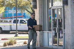 Investigators, including FBI officers, rope off a FedEx Office store located in the Southwest Austin suburb of Sunset Valley on March 20, 2018. Sunset Valley police think that a package that exploded early Tuesday at a FedEx sorting facility in Schertz may have been shipped from this FedEx Office location. Photo by Reshma Kirpalani/Austin American-Statesman/TNS/ABACAPRESS.COM