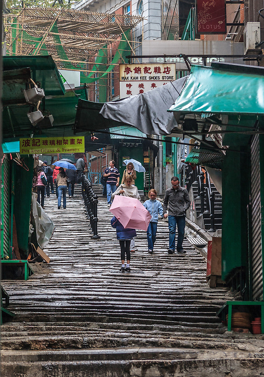 """Pottinger Street or Stone Slabs Street in Hong Kong, China. The stone slabs were unevenly paved on it to facilitate walking and allow rainwater to flow down along either side. The street was named in 1858 """"Pottinger Street"""" to commemorate the first governor of Hong Kong."""