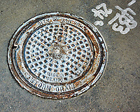 San Diego storm drain manhole cover (made in Mexico). Image taken with a Nikon 1 V3 camera and 10 mm VR lens (ISO 200, 15 mm, f/4.2, 1/640 sec).
