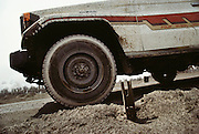 An unexploded rockeye submunition (cluster bomb), in the Al-Burgan Oil Field. After finding these rockeye submunitions all over Kuwait, the British Explosive Ordinance Disposal Team detonate them with plastic explosives from a safe distance. .