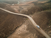 Aerial view of a car on a curvy road of The Natural Park of Jandía in Fuerteventura, Canary Islands.