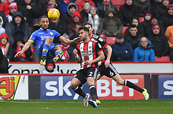 Leeds United's Kemar Roofe (left) tries an overhead shot on goal