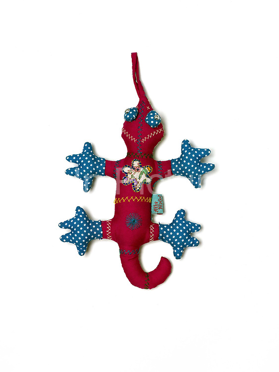 Child's fabric toy gecko made by the Akha Puxo women in Ban Papounkao, Phongsaly province, Lao PDR. Akha Biladjo is an independent project set up in 2003 by Cecile Pouget in Phongsaly Province. Using traditional skills Akha women create modern designs, to gain a sustainable income.