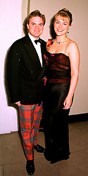 LORD & LADY DALMENY at a dinner in London on 23rd October 1998.MLD 19