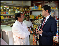 Ed Miliband during an East Street Market. During the visit he was egged by a member of public during a  living standards related visit to South East London's East Street Market.  This is Milliband's first official visit since coming back from holiday, <br /> East Street Market, London, United Kingdom. Wednesday, 14th August 2013. Picture by Andrew Parsons / i-Images