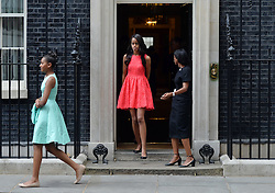 © Licensed to London News Pictures. 16/06/2015. <br /> LONDON, UK. DaughterS of Michelle Obama, SASHA OBAMA (left) and MALIA OBAMA (right) depart Downing Street after accompanying her mother to have tea with David and Samantha Cameron, London, Tuesday 16 June 2015. Photo credit : Hannah McKay/LNP