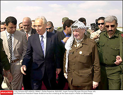 © Avi Ochaion/KRT/ABACA. 28940-1. Rafah-Palestine, 26/9/2001. Israeli Foreign Minister Shimon Peres, left, and Palestinian President Yasser Arafat arrive for a meeting at the Gaza airport in Rafah on Wednesday.