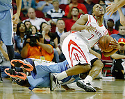 April 16, 2012; Houston, TX, USA; Denver Nuggets point guard Ty Lawson (3) fouls Houston Rockets point guard Kyle Lowry (7) during the fourth quarter at the Toyota Center. The Nuggets won 105-102. Mandatory Credit: Thomas Campbell-US PRESSWIRE