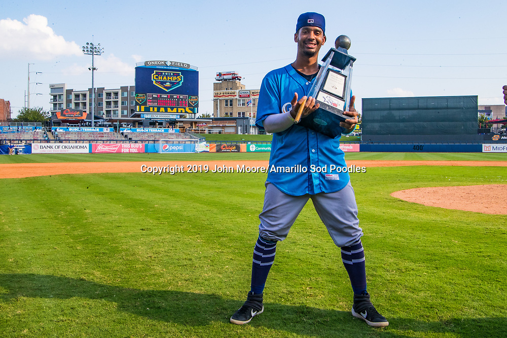 Amarillo Sod Poodles infielder Ivan Castillo (2) poses with the trophy after the Sod Poodles won against the Tulsa Drillers during the Texas League Championship on Sunday, Sept. 15, 2019, at OneOK Field in Tulsa, Oklahoma. [Photo by John Moore/Amarillo Sod Poodles]