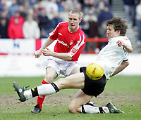 Photo: Paul Thomas. Nottingham Forest v Derby County. Forest Ground, Nottingham. Coca Cola Championship. 26/02/2005. John Curtis and Grzegorz Rasiak.