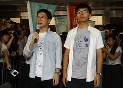 August 17, 2017 - Hong Kong, CHINA - Chairman of Localist political party DEMOSISTO, and the disqualified lawmaker, Nathan Law ( L ) and former student leader and prominent figure in the 2014 OCCUPY CENTRAL-UMBRELLA REVOLUTION, Joshua Wong ( R ) stands before the media outside High Court. Hong Kong pro-democracy activists Joshua Wong, Nathan Law and Alex Chow are sentenced 6 to 8 years in jail respectively after High Court announced their verdict today. Aug 17,2017.Hong Kong.ZUMA/Liau Chung Ren (Credit Image: © Liau Chung Ren via ZUMA Wire)