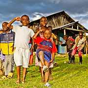 Taachasis' children snap to attention as their visitors prepare to depart. Nandi County, Keny'a Rift Valley Province.