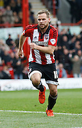 Brentford midfielder Alan Judge runs towards the fans to celebrate after his second goal of the game during the Sky Bet Championship match between Brentford and Rotherham United at Griffin Park, London, England on 17 October 2015. Photo by Andy Walter.