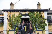 Passengers exiting Howth railway station on 09th April 2017 in County Dublin, Republic of Ireland. Howth is an Irish village on the Howth Peninsula, east of central Dublin.