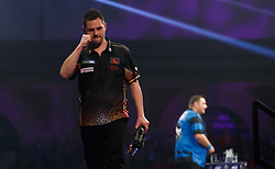Toni Alcinas clebrates defeating Kevin Munch during day eleven of the William Hill World Darts Championship at Alexandra Palace, London.