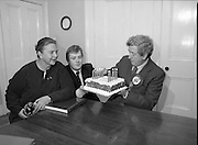 Garret Fitzgerald Birthday.1982.09.02.1982..02.09.1982..9th February 1982.Photo shows.Garret Fitzgerald celebrating his 56th birthday.Garret,his wife Joan and son Mark, take the time to clebrate his birthday at their Palmerstown home.   .Mr Fitzgerald was in the middle of a general election campaign. Note the campaign badge on his lapel.