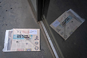 A weekend edition of the FT (Financial Times) newspaper whose wrapper announces that this is the new agenda, lies discarded outside company offices in the City of London - the capital's financial district, on 4th April 2021, in London, England.