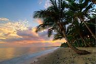 Sunset colours on a coral coast beach. Fiji.