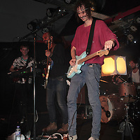 Darwin Deez (real name Darwin Smith)checks the tuning on a replacement guitar while the band carries on with a special extended remix of DNA live at Sound Control, Manchester, 2013-02-15