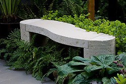 Simple curved stone bench seat