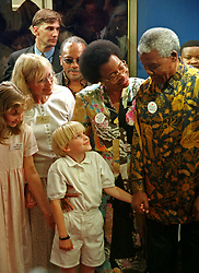 Oct. 22, 1997 - Cape Town, South Africa - NELSON MANDELA and GRACA MACHEL talk to MIA FARROW and her children on the platform of Worcester Station after the Blue Train stopped during the Nelson Mandela Blue Train Fund Raising experience. (Credit Image: © Sasa Kralj/JiwaFoto/ZUMAPRESS.com)