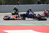 #99 Jorge Lorenzo, Spanish: Repsol Honda Team crashes  and takes out #4 Andrea Dovizioso, Italian: Mission Winnow Ducati Team, #12 Maverick Vinales, Spanish: Movistar Yamaha, and #46 Valentino Rossi, Italian: Movistar Yamaha MotoGP during the Gran Premi Monster Energy de Catalunya at Circuit de Barcelona – Catalunya, Barcelona, Spain on 16 June 2019.