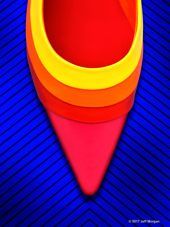 Still life image of a bright colorful woman shoe.
