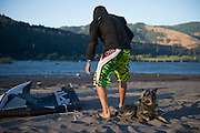 Chano and Fernando Gomez travel the coast on a BMW R1150GS motorcycle, campign and kiteboarding the coast.  Chano is a blue heeler mix and guards the gear on the beach while Fernando kiteboards.