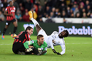 QPR goalkeeper Robert Green and defender Richard Dunne block a shot from Swansea city's Wilfried Bony which just goes over the crossbar. Barclays Premier league match, Swansea city v Queens Park Rangers at the Liberty stadium in Swansea, South Wales on Tuesday 2nd December 2014<br /> pic by Andrew Orchard, Andrew Orchard sports photography.