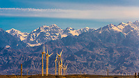 Wind turbines with the Tian Shan mountains in the background, near Urumqi, Xinjiang Province, China.