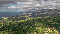 Aerial view of wonderful coast colourful mountains with heavy clouds before a storm in Marbella, Spain