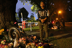 March 16, 2019 - Christchurch, New Zealand - The very brave Kevin Huisena, who had returned for the candlelight vigil, only after fleeing the Deans Rd mosque when the shooting began. One of his friends who he attended the mosque with is still missing and presumed to be still in the mosque deceased. Around 50 people has been reportedly killed a terrorist attack on two Christchurch mosques. (Credit Image: © Adam Bradley/SOPA Images via ZUMA Wire)