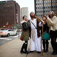 """Leah DeTommaso, 19, Alisyn Davidson, 19, and Taylor Moran, 18, ask to take a photograph with (center) Michael Grant, 28, """"Philly Jesus."""" Nearly everyday for the last 8 months, Grant has dressed as Jesus Christ, and walked the streets of Philadelphia to share the Christian gospel by example.  He quickly acquired the nickname of """"Philly Jesus,"""" which he has gone by ever since."""