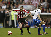 Photo: Aidan Ellis.<br /> Sheffield United v Middlesbrough. The Barclays Premiership. 30/09/2006.<br /> Sheffield's Alan Quinn gets the better of Boro's Jonathon Woodgate